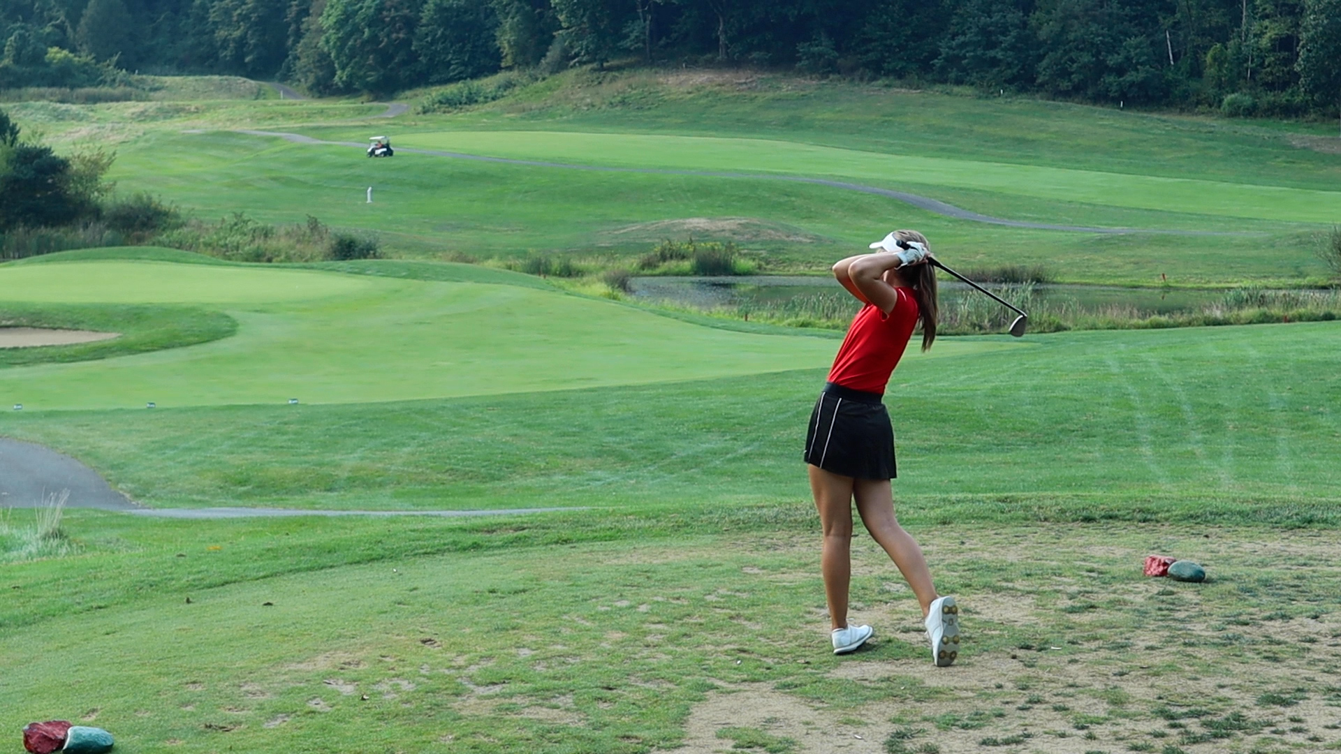 New Philadelphia senior Sydney Devore tees off on the fifth hole of Oak Shadows' back nine in the Quakers' match against Fairless High School on Monday, September 13, 2021.