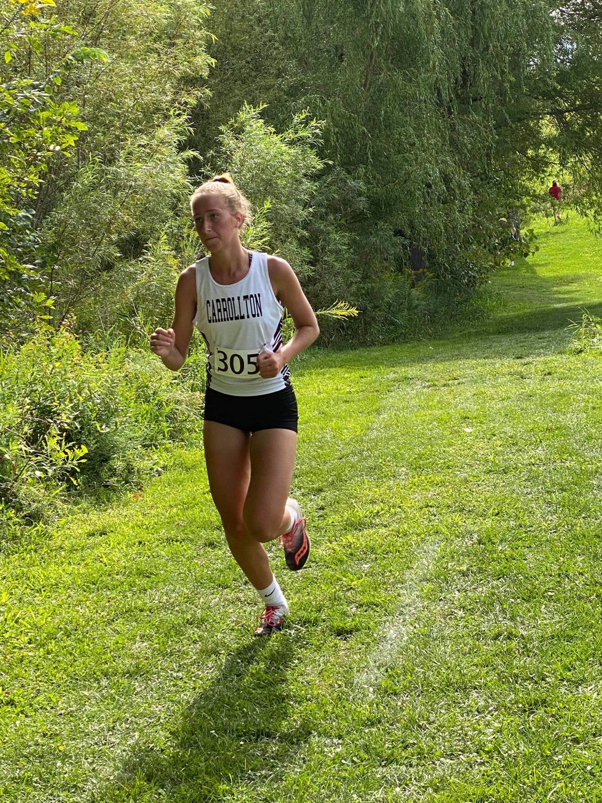 Carrollton cross country runner Hillari Baker competes at the Northwest Cross Country Invitational at GlenOak High School on Saturday, September 4, 2021.