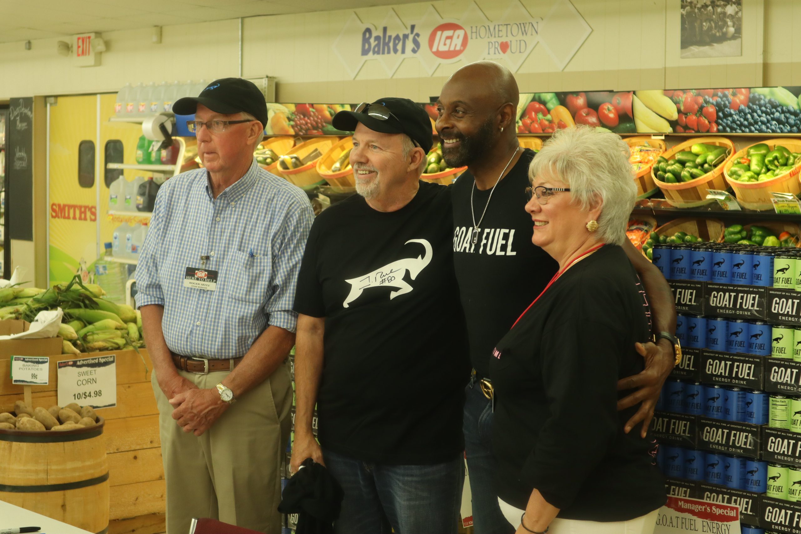 Former NFL superstar Jerry Rice poses with Baker's IGA supermarket staff and management in Newcomerstown, Ohio on Friday, September 3.